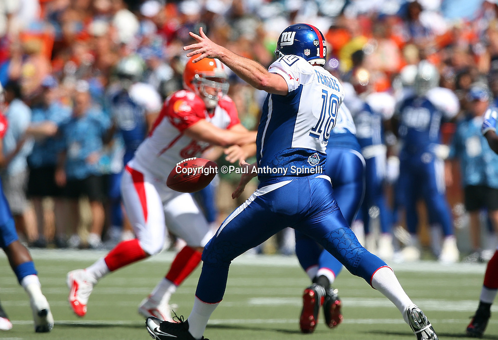 HONOLULU, HI - FEBRUARY 08: NFC All-Stars punter Jeff Feagles #18 of the New York Giants punts the ball to the AFC All-Stars in the 2009 NFL Pro Bowl at Aloha Stadium on February 8, 2009 in Honolulu, Hawaii. The NFC defeated the AFC 30-21. ©Paul Anthony Spinelli *** Local Caption *** Jeff Feagles