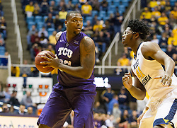 Feb 13, 2016; Morgantown, WV, USA; TCU Horned Frogs forward Chris Washburn (33) holds the ball while being guarded by West Virginia Mountaineers forward Devin Williams (41) during the first half at the WVU Coliseum. Mandatory Credit: Ben Queen-USA TODAY Sports