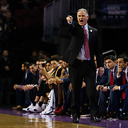 15 March 2018: San Diego State Aztecs head coach Brian Dutcher yells in a play to his offense in the first half. The San Diego State Aztecs got knocked out in the first round by Houston on a last second layup to lose 67-65  at Intrust Bank Arena in Wichita, Kansas.