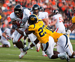 November 7, 2009; Berkeley, CA, USA;  Oregon State Beavers wide receiver James Rodgers (8) breaks a tackle by California Golden Bears cornerback Josh Hill (23) to score a touchdown during the second quarter at Memorial Stadium.