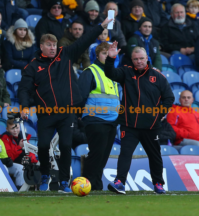 Mansfield&rsquo;s Manager Steve Evans and assistant paul Raynor seen during the Sky Bet League 2 match between Mansfield Town and Crawley Town at the One Call Stadium in Mansfield. November 19, 2016.<br /> James Boardman / Telephoto Images<br /> +44 7967 642437