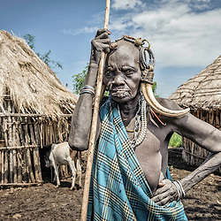 Portrait of an old Mursi woman with typical ornaments, Omo valley, Ethiopia