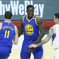 07 December 2016: Golden State Warriors guard Klay Thompson (11) drives past LA Clippers guard J.J. Redick (4) on a screen set by Golden State Warriors forward Draymond Green (23) during the Golden State Warriors 115-98 victory over the Los Angeles Clippers, at the Staples Center, Los Angeles, California, USA.