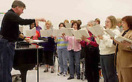 Hank Dahlman leads the women of the Dayton Philharmonic Chorus as they rehearse for their upcoming performance of Mahler's Third Symphony, Tuesday, January 2, 2007. In the front row are (left to right) Lillian Chambliss, Anita Campbell, Jill Lewis, Pat Armstrong, Ellen Barnett, Donita Carman and Sharon Williamson.