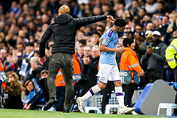 Phil Foden of Manchester City shakes hands with Manchester City manager Pep Guardiola after being shown a red card and sent off - Mandatory by-line: Robbie Stephenson/JMP - 22/10/2019 - FOOTBALL - Etihad Stadium - Manchester, England - Manchester City v Atalanta - UEFA Champions League Group Stage