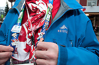 Councillor Chris Quinlan shows off his collection of Olympic Pins during the 2010 Olympic Winter Games in Whistler, BC Canada.