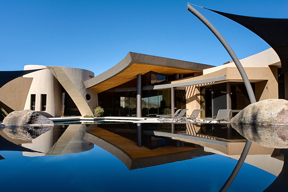 Photo of large Modern estate  reflection in pool. Home at Big Horn Golf Club in Palm Desert, CA. Designed by Patel Architecture.