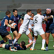 After grabbing USA Eagle Danny Barrett's jersey, England's Tom Mitchell is tended to by USA's Folau Niua, as England's Dan Norton and USA Captain Madison Hughes try to get cooler heads to prevail...the incident ignited into a further confrontation, at day 2 of the World Cup 7's USA, AT&T Park, San Francisco, California, USA.  England narrowly defeated the USA Eagles in extra time, 24-19.  Photo by Barry Markowitz, 7/21/18, 5pm
