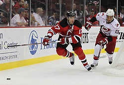 Oct 10; Newark, NJ, USA;New Jersey Devils left wing Ilya Kovalchuk (17) skates with the puck by Carolina Hurricanes right wing Anthony Stewart (13) during the first period at the Prudential Center.