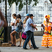 03/10/2017  OLD HAVANA, CUBA    A woman in costume offers to pose in photos with tourists in Plaza de Armas in Old Havana, Cuba.  (Aram Boghosian for The New Orleans Advocate)