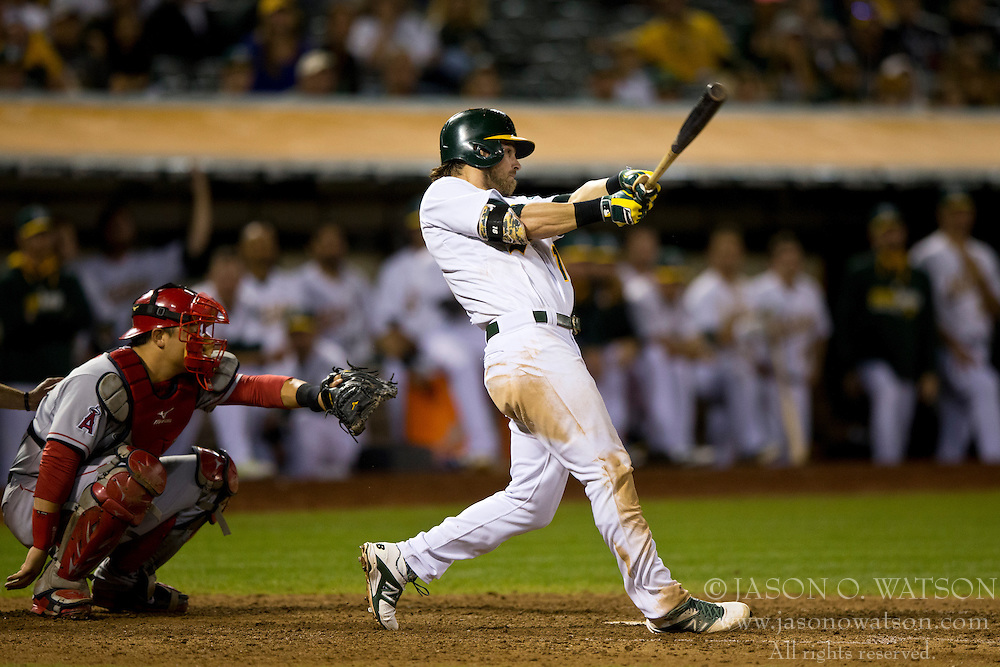 OAKLAND, CA - SEPTEMBER 23:  Josh Reddick #16 of the Oakland Athletics at bat against the Los Angeles Angels of Anaheim during the ninth inning at O.co Coliseum on September 23, 2014 in Oakland, California. The Los Angeles Angels of Anaheim defeated the Oakland Athletics 2-0.  (Photo by Jason O. Watson/Getty Images) *** Local Caption *** Josh Reddick