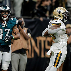 Nov 18, 2018; New Orleans, LA, USA; New Orleans Saints running back Alvin Kamara (41) celebrates after a touchdown as Philadelphia Eagles safety Tre Sullivan (37) looks on during the second half at the Mercedes-Benz Superdome. Mandatory Credit: Derick E. Hingle-USA TODAY Sports