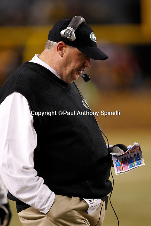 New York Jets head coach Rex Ryan looks at his play chart during the NFL 2011 AFC Championship playoff football game against the Pittsburgh Steelers on Sunday, January 23, 2011 in Pittsburgh, Pennsylvania. The Steelers won the game 24-19. (©Paul Anthony Spinelli)