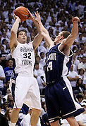 BYU's Jimmer Fredette (32) attempts to score as Utah State's Tyler Newbold (24) defends during the first half of an NCAA college basketball game, Wednesday, Nov. 17, 2010 in Provo, Utah. Fredette scored 26 points in BYU's 78-72 win over Utah State. (AP Photo/Colin E Braley)