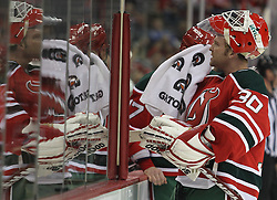 Mar 18; Newark, NJ, USA; New Jersey Devils goalie Martin Brodeur (30) towels off during the third period at the Prudential Center. The Washington Capitals defeated the New Jersey Devils 3-0.