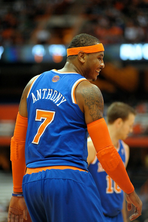 New York Knicks forward CARMELO ANTHONY (7) shares a laugh during a break in the action against the Philadelphia 76ers in the second quarter at the Carrier Dome in Syracuse, NY. Philadelphia defeated New York 98-90.