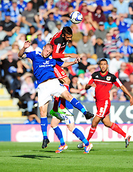 Bristol City Captain, Liam Fontaine battles for the high ball with Leicester City's Jamie Vardy - Photo mandatory by-line: Joe Meredith/JMP  - Tel: Mobile:07966 386802 06/10/2012 - Leicester City v Bristol City - SPORT - FOOTBALL - Championship -  Leicester  - King Power Stadium
