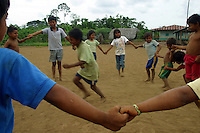 Achuar Indian kids play a game in the village of Pumpuentsa, in Ecuador's Amazonian jungle. (Photo/Scott Dalton)