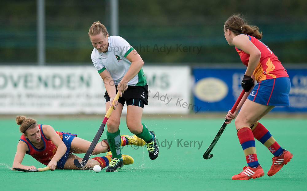 Canterbury's Mel Clewlow gets away from University of Birmingham's Lily Owsley during their Investec Women's Hockey League Premier Division game at Polo Farm, Canterbury, Kent, 21st September 2013.