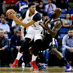 Mar 7, 2016; New Orleans, LA, USA; New Orleans Pelicans forward Anthony Davis (23) is defended by Sacramento Kings forward Quincy Acy (13) during the first quarter of a game at the Smoothie King Center. Mandatory Credit: Derick E. Hingle-USA TODAY Sports