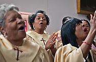 Sharon Lavigne, founder of Rise St. James, singing at Geraldine Mayho's funeral at the St. James Cathlic Church.