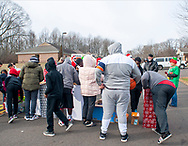 Residents of the group home wait for the gifts to be handed members of the Delaware Valley Iron Indian Riders Association held their annual Ride Of the Santas and dropped off toys to children at  Saturday, December 21, 2019 at St Francis-St Vincent Home For Children in Bensalem, Pennsylvania. (Photo by William Thomas Cain / CAIN IMAGES)