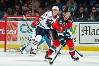 KELOWNA, BC - OCTOBER 12: Brodi Stuart #17 of the Kamloops Blazers looks for the pass between Sean Comrie #3 and Roman Basran #30 of the Kelowna Rockets at Prospera Place on October 12, 2019 in Kelowna, Canada. (Photo by Marissa Baecker/Shoot the Breeze)
