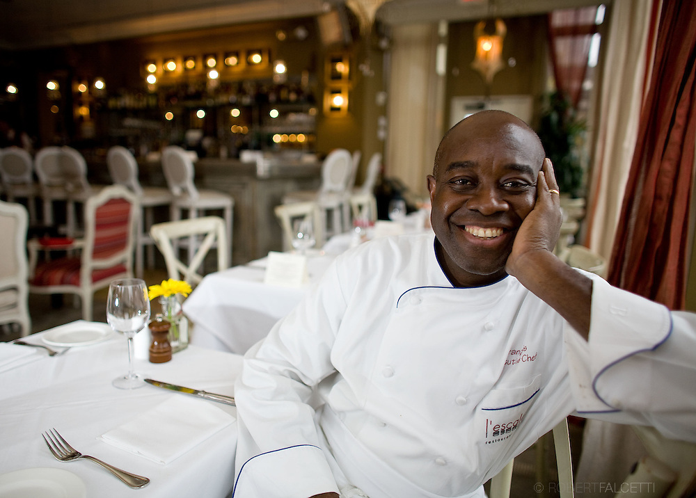 GREENWICH, CT- NOVEMBER 8, 2008:  Francois Kwaku-Dongo, Executive Chef at L'Escale sits for a portrait in the dining room of the upscale French restaurant in Greenwich, Connecticut. A recession in the economy has brought less of the wealthy customers to the establishment than in the past. (Photo by Robert Falcetti)    ...