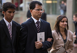 © licensed to London News Pictures. London, UK. 15/12/2012. The son Junal (left), husband Ben Barboza (centre) and The daughter Lisha (right), of nurse Jacinta Saldanha arrive at Westminster Cathedral in London to attend a memorial service held for Jacinta Saldanha who committed suicide. Photo credit: Tolga Akmen/LNP