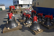 UK, Penzance - Monday, March 23, 2009: The eight bells stand on the quay before loading onto the Isles of Scilly Steamship Company's supply vessel the Gry Maritha to be transported to St Mary's on the Isles of Scilly. (Image by Peter Horrell / http://www.peterhorrell.com)