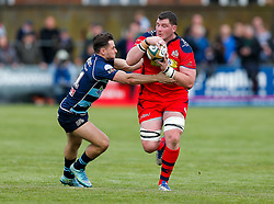 Bristol Rugby Number 8 James Phillips is tackled by Bedford Blues Winger Dean Adamson - Mandatory byline: Rogan Thomson/JMP - 01/05/2016 - RUGBY UNION - Goldington Road - Bedford, England - Bedford Blues v Bristol Rugby - Greene King IPA Championship Play Off Semi Final 1st Leg.