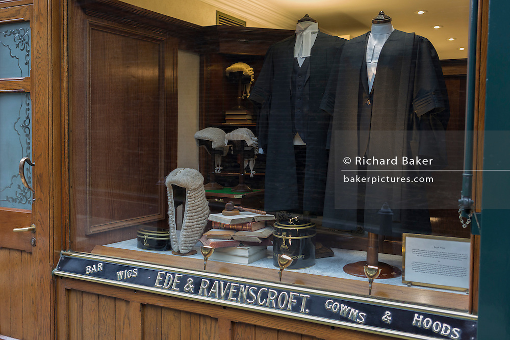 Court dress wigs and gowns for the legal profession (barristers and judges) in the window of Ede & Ravenscroft, on 15th February 2017, in London, United Kingdom.