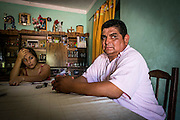 2014/11/24 – El Colorado, Argentina: Jorge Gomez (51) in his house with his wife. Jorge is what you can call the Mayor of the El Colorado village, close to Quimili in Santiago de Estero Province. He is also a farmer but doesn't support the massive soy cultivation, since he claims it is destroying the soils and their future, and also getting everyone in the village ill because of the fumigations with glysophate. El Colorado is surrounded by soy fields and most of the population is depent on them to make a living. (Eduardo Leal)