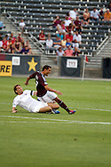 July 24th, 2012:  Colorado Rapids forward Kamani Hill (13) gets taken out in the Rapids 2-1 win over Swansea City AFC in a international friendly soccer match in Denver, CO.