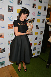 EVA LANSKA and her dog Mimi at A Date With Your Dog At George in aid of the Dogs Trust held at George, 87-88 Mount Street, London on 9th September 2014.