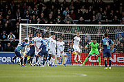 Wycombe Wanderers Bryn Morris(17) sees his free kick deflect off Peterborough United midfielder Louis Reed (11) and find the corner of the net 1-0 during the EFL Sky Bet League 1 match between Wycombe Wanderers and Peterborough United at Adams Park, High Wycombe, England on 3 November 2018.