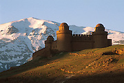 SPAIN, ANDALUSIA LA CALAHORRA; 16thC 'renaissance style' castle with the Sierra Nevada Mountains beyond, southeast of Granada