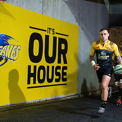 Hurricanes captain TJ Perenara leads his team out for the Super Rugby semifinal match between the Hurricanes and Chiefs at Westpac Stadium, Wellington, New Zealand on Saturday, 30 July 2016. Photo: Dave Lintott / lintottphoto.co.nz