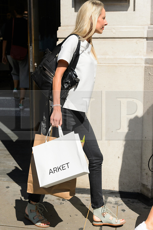 © Licensed to London News Pictures. 25/08/2017. London, UK. A customer leaving with shopping bags at the opening of H&M group's first ARKET flagship clothing store in Regent Street. ARKET has called itself a modern day market seeing not only clothes, but homeware as well as a small cafe space. Photo credit: Ray Tang/LNP