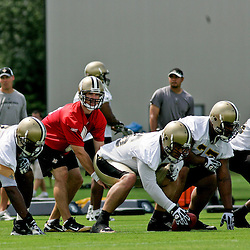 June 5, 2010; Metairie, LA, USA; New Orleans Saints quarterback Drew Brees (9) under center for offensive drills during a mini camp practice at the New Orleans Saints practice facility. Mandatory Credit: Derick E. Hingle
