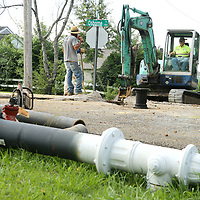 David Johnson, a forman with Paul Smithey Construction in Tupelo, works the backhoe to dig as he and his crew work on upgrading the water system in the Joyner neighborhood on Wednesday morning in Tupelo.