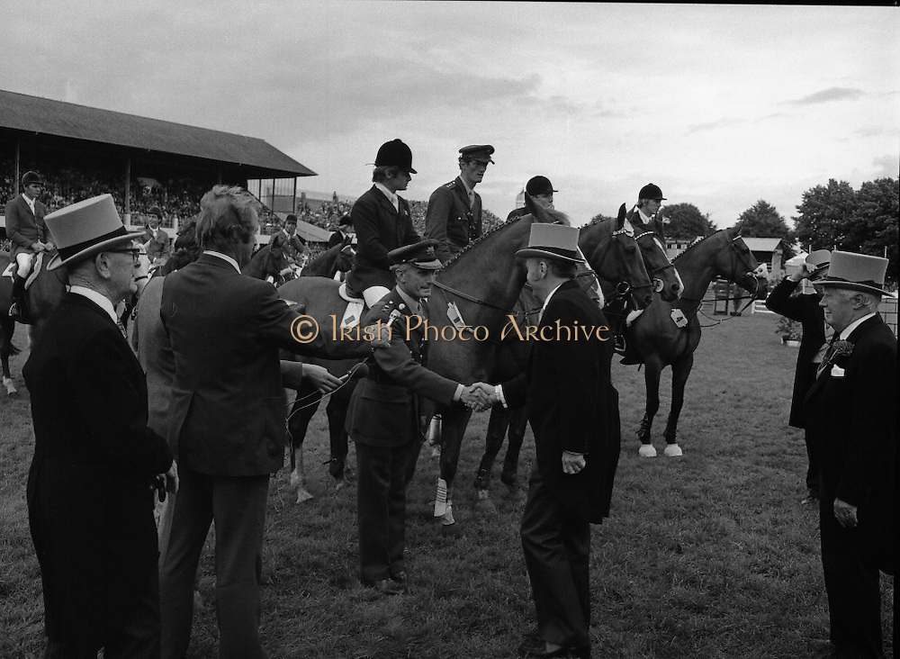 Aga Khan Trophy..1979..10.08.1979..08.10.1979..10th August 1979..The annual staging of the Aga Khan Cup took place  at the Royal Dublin Showgrounds, Ballsbridge,Dublin today.It was the first time since 1937 that Ireland won the trophy outright. The winning Irish team comprised of Paul Darragh,Capt Con Power,James Kernan and Eddie Macken..President, Dr Patrick Hillery, is pictured congratulating Col Ringrose on the achievment of the Irish team in winning the Aga Khan Cup.