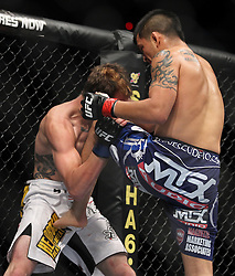 May 29, 2010; Las Vegas, NV; USA;  Efrain Escudero (blue trunks) and Dan Lauzon (white trunks) fight during their bout at UFC 114 at the MGM Grand Garden Arena in Las Vegas.