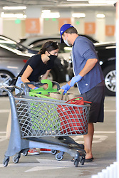 EXCLUSIVE: Actor Leo DiCaprio looks very much domesticated as he is seen grocery shopping with his girlfriend Camilla Morrone at Eataly. The couple appeared so hungry that they also ordered pizzas which they finished in the parking lot of the store. Camilla appeared to injure her hand as she helped Leo load the car up. The couple took no risks as they both wore masks and gloves during their trip to the store. 08 Jun 2020 Pictured: Leonardo Di Caprio, Camilla Morrone. Photo credit: Rachpoot/Photog Group/MEGA TheMegaAgency.com +1 888 505 6342