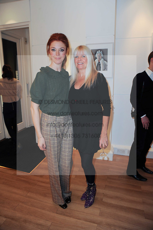 Left to right, TAMARA BECKWITH and LINDSEY CARLOS CLARKE at a private view of photographs held at the Little Black Gallery, Park Walk, London on 20th January 2010.