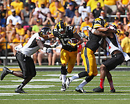 August 31 2013: Iowa Hawkeyes wide receiver Jacob Hillyer (17) tries to hold off Northern Illinois Huskies linebacker Rasheen Lemon (9) during the second quarter of the NCAA football game between the Northern Illinois Huskies and the Iowa Hawkeyes at Kinnick Stadium in Iowa City, Iowa on August 31, 2013. Northern Illinois defeated Iowa 30-27.