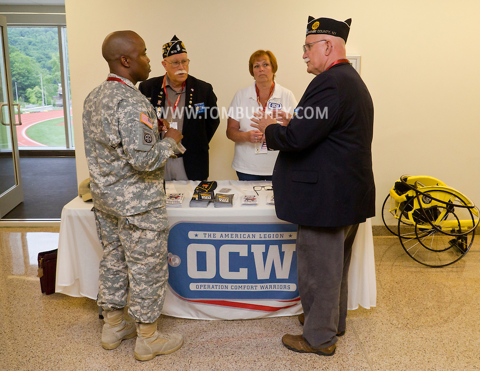 West Point, New York - LTC Keith L. Williams, outgoing adaptive sports and reconditioning branch chief of the U.S. Army Warrior Transition Command (WTC) meets with an American Legion Operation Comfort Warriors team at the United States Military Academy Preparatory School on Monday, June 9, 2014.<br />