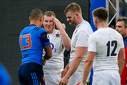 Injured England Hooker Dylan Hartley (capt) points to his head after going off on a stretcher with a head injury after winning the match to complete their Six Nations title with the Grand Slam - Mandatory byline: Rogan Thomson/JMP - 19/03/2016 - RUGBY UNION - Stade de France - Paris, France - France v England - RBS 6 Nations 2016.