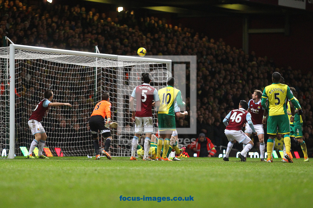 Picture by Paul Chesterton/Focus Images Ltd +44 7904 640267<br /> 11/02/2014<br /> Adrian of West Ham punches clear but the ball falls to Joseph Yobo of Norwich who puts it over the bar during the Barclays Premier League match at the Boleyn Ground, London