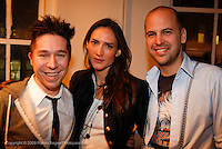 "Brian Wolk, Zani Guggelman and Claude Morais attend the opening of ""Lady"" by Douglas Friedman at the Ruffian Gallery on April 23, 2009 in New York City."